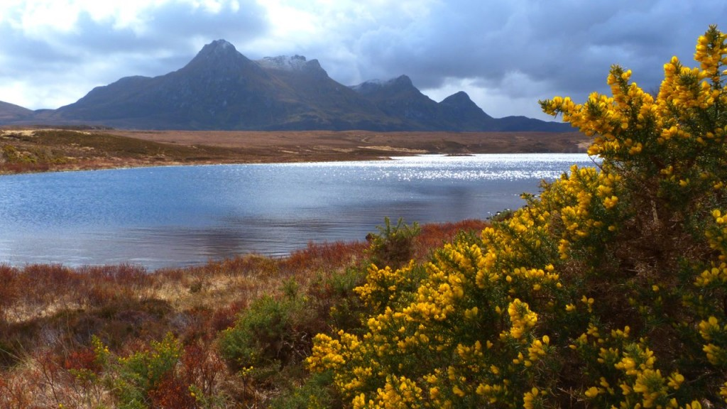 Loch Hakel at the foot of Ben Loyal. Snow cloud just moved over to reveal the sun once again.